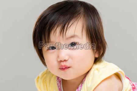 little girl pouting lip