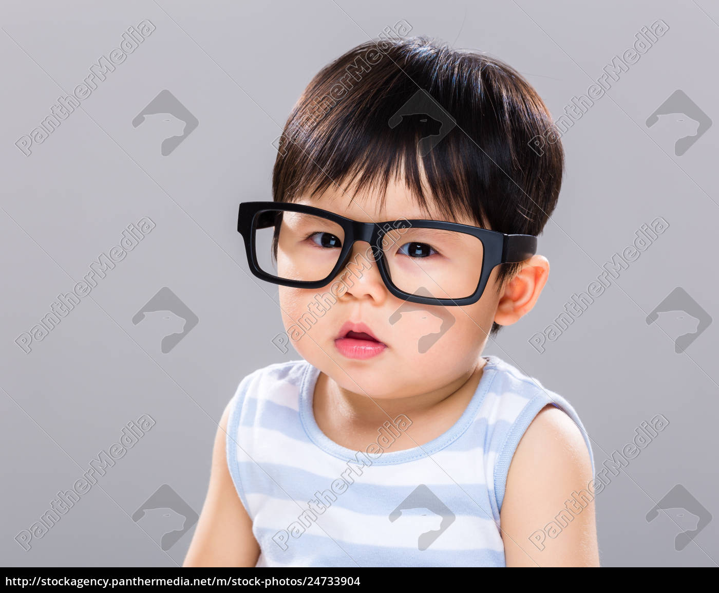 Royalty free photo 24733904 - Asian baby boy with black glasses
