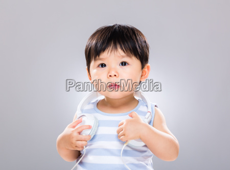little boy with music headphone on