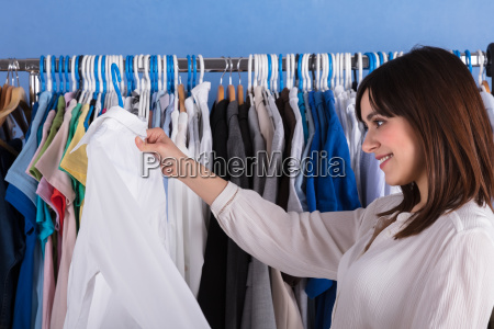 woman looking at white cloth