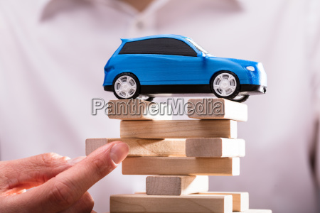 blue car over stacked wooden blocks