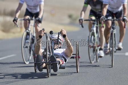 disabled racing cyclist riding recumbent bicycle