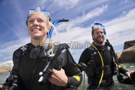 portrait of happy scuba diver woman