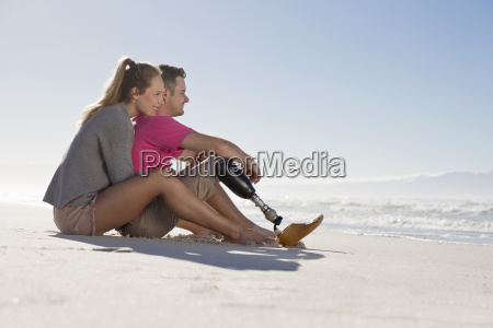 man with artificial leg sitting and