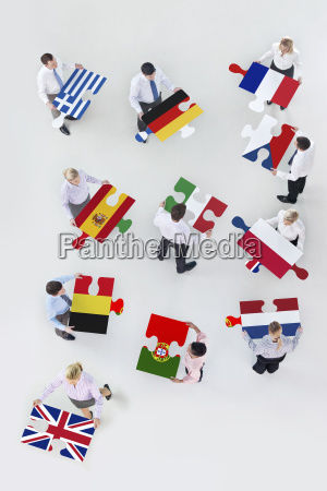 overhead view of business people holding