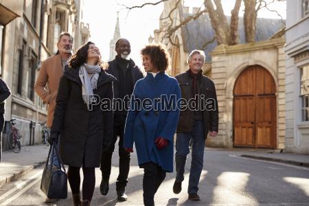 group of mature friends walking through