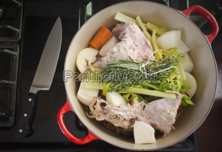 turkey leftovers and vegetables in pot