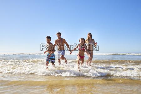 family, on, summer, beach, vacation, run - 24749890