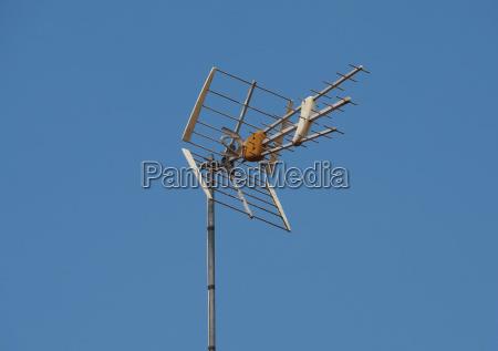 tv antenna aerial over blue sky