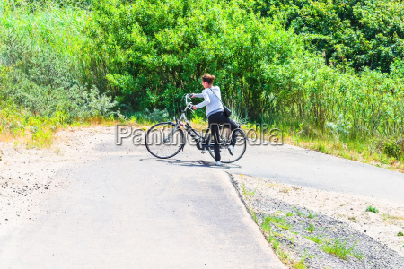young woman with the e bike