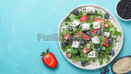 salad with arugula feta strawberry blueberry