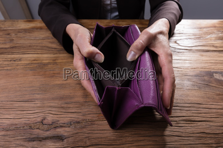 businessperson holding empty purse