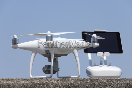 drone and remote controller clear blue