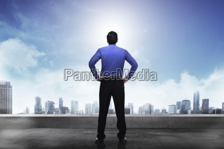 rear view of businessman in blue