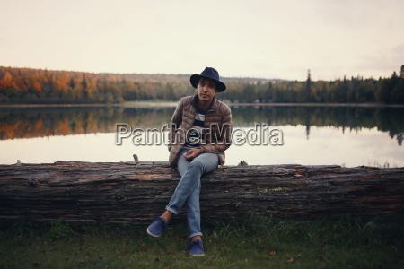 full length portrait of man sitting