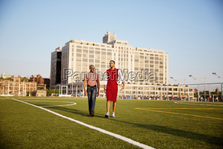 man and father walking on soccer