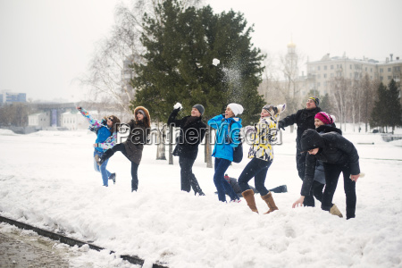 friends playing with snow at park