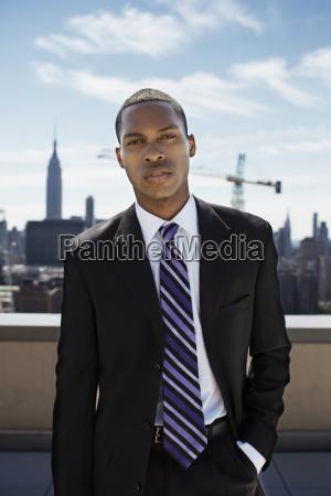 portrait of businessman standing on building