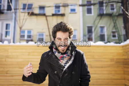 man playing with snow while standing