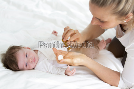 beautiful young mother is giving her