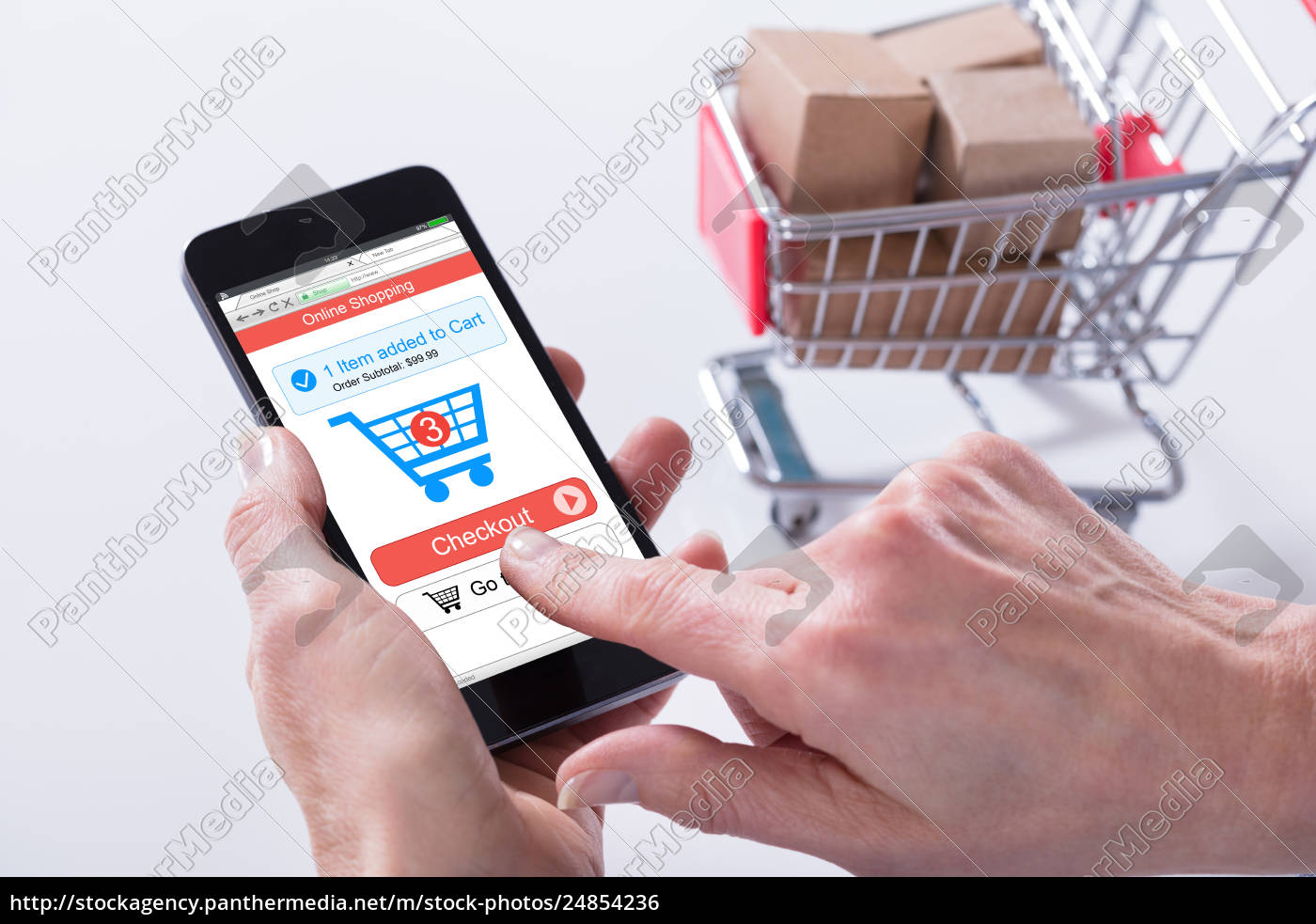 Royalty free photo 24854236 - Person Using Online Shopping Application On  Mobile Phone