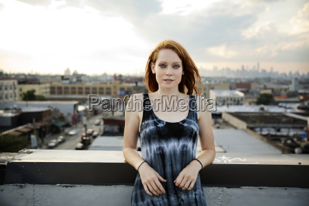 portrait of young woman standing at