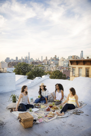 female friends enjoying food at party