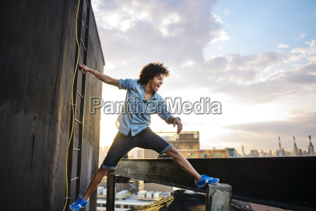 young man having fun by building