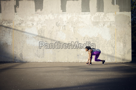 woman in starting position on street