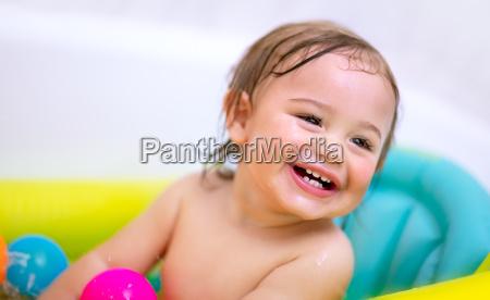 sweet child taking bath