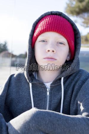 portrait of confident boy wearing knit
