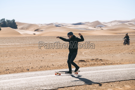 full length of man skateboarding on