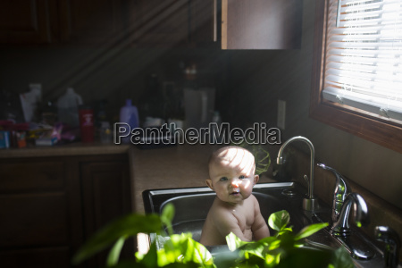 portrait of cute shirtless baby girl