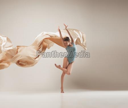 modern ballet dancer dancing in full