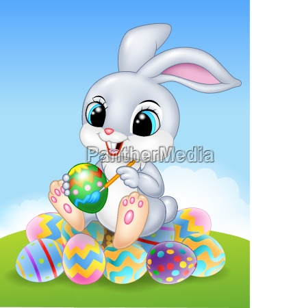 cartoon easter bunny painting an egg