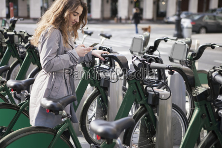 young woman text messaging through smart