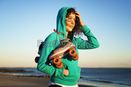 woman standing on beach with roller