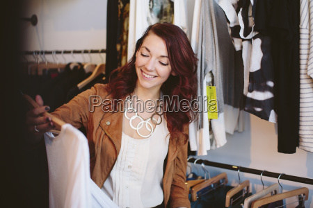 smiling owner working in store