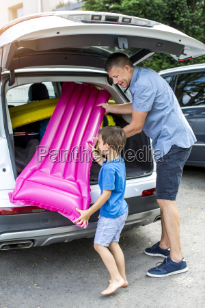 father and son are packing car