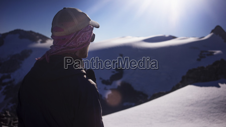 man standing at snow covered field
