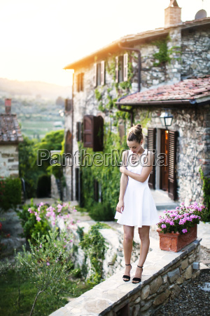 woman standing on retaining wall against