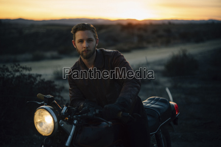 portrait of man riding motorcycle on