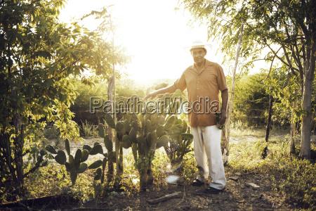 portrait of man standing on field
