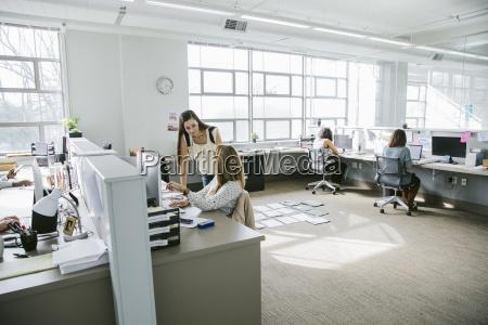 businesswomen working at desks in office
