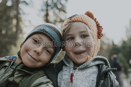 portrait of smiling brothers wearing knit