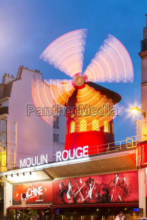 illuminated windmill on moulin rouge against
