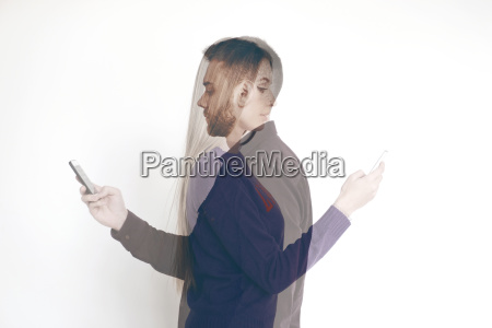 double exposure of couple using mobile
