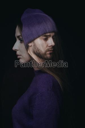 double exposure of sad couple standing