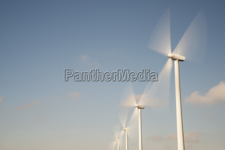 low angle view of wind turbines