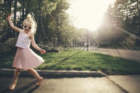 smiling girl enjoying on street by